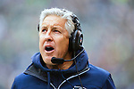 Seattle Seahawks head coach Pete Carroll talks to his coaching staff in their game against the  St. Louis Rams  at CenturyLink Field in Seattle, Washington on December 29, 2013.  Seahawks clinched the NFC West title and home-field advantage throughout the playoffs with a 27-9 victory over the St. Louis Rams.  ©2013. Jim Bryant Photo. ALL RIGHTS RESERVED.