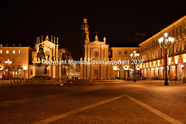 Piazza San Carlo in Turin, Italy at night with the churches of San Carlo and Santa Cristina in the background