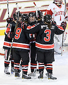 The Huskies celebrate Dani Rylan's (NU - 2) game-tying goal. - The Northeastern University Huskies tied Boston University Terriers 3-3 in the 2011 Beanpot consolation game on Tuesday, February 15, 2011, at Conte Forum in Chestnut Hill, Massachusetts.