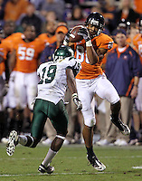 Oct 23, 2010; Charlottesville, VA, USA;  Virginia Cavaliers wide receiver Ray Keys (86) intercepts the ball in front of Eastern Michigan Eagles cornerback Arrington Hicks (19) during the 2nd half of the game at Scott Stadium. Virginia won 48-21. Mandatory Credit: Andrew Shurtleff