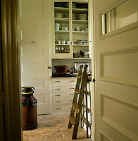 Glass-fronted cupboards offer the perfect combination, displaying a collection of china while protecting the pieces from dust