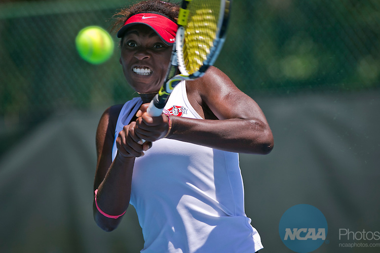17 MAY 2014:  Barry's Elisabeth Abanda returns a shot from Armstrong's Clara Perez during their singles match. Barry University defeated Armstrong Atlantic State University 5-4 to win the individual national title during the Division II Women's Tennis Championship held at Sanlando Park in Altamonte Springs, FL.  Matt Marriott/NCAA Photos