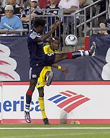 Columbus Crew defender Shaun Francis (29) crosses the ball past Emmanuel Osei. The New England Revolution tied Columbus Crew, 2-2, at Gillette Stadium on September 25, 2010.