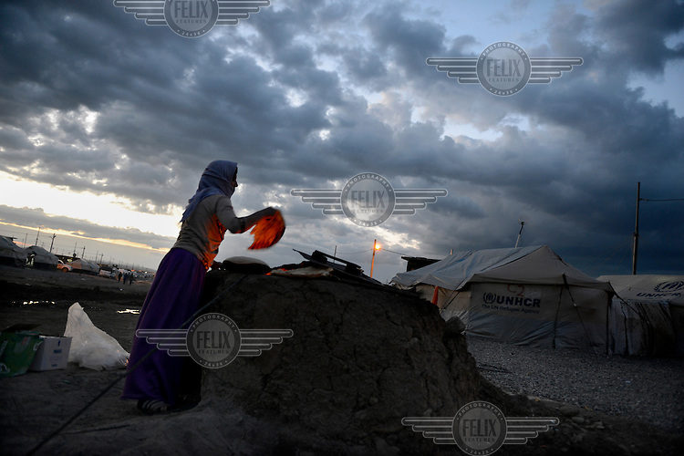A Yazidi refugee woman makes bread in a refugee camp in Dohuk, Iraq.<br /> Thousands of Yazidis fled their homes when Islamic State (IS) attacked Yazidi towns and villages in August 2014. Many are now living in refugee camps.