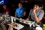 Chaitanya Acharya tries to keep it together during the sushi challenge at Kanki Japanese House of Steaks and Sushi, Durham, NC, March 19, 2012. Acharya took on the sushi challenge with fellow colleagues from the oncology department at Duke Hospital.