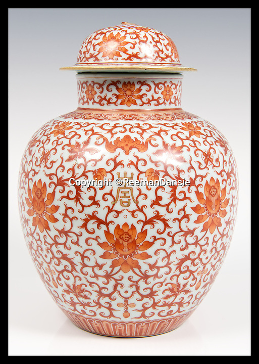 BNPS.co.uk (01202 558833)<br /> Pic: ReemanDansie/BNPS<br /> <br /> ***Please Use Full Byline***<br /> <br /> A vase, also owned by the family of Major Jack Tulloch sold for &pound;33,000 at the same auction as the bowl.<br /> <br /> A battered bowl that was until recently the favourite sleeping place for a pet cat has sold for 108,000 pounds.<br /> <br /> The 12inch wide bowl has chips, cracks and staples in from where it was once repaired after being broken in two.<br /> <br /> Its owners kept the Chinese piece on a chest of drawers in their hallway and it was used as a bizarre bed for their moggy.<br /> <br /> Auctioneers gave it a 200 pounds estimate but were stunned when it went under the hammer for 90,000 pounds, or 108,000 pounds including fees.