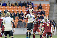 Houston, TX - Friday December 9, 2016: Ian Harkes (16) of the Wake Forest Demon Deacons gains control of a loose ball in the first half against the Denver Pioneers at the NCAA Men's Soccer Semifinals at BBVA Compass Stadium.