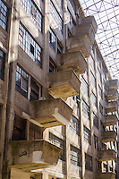 The skylit atrium of the Brooklyn Army Terminal (BAT) in Sunset Park in Brooklyn in New York is seen on Saturday, September 21, 2013. Originally the NY Port of Embarkation and Army Supply Base, also the Military Ocean Terminal, the BAT was built in 1918 and designed by noted architect Cass Gilbert, who also designed the Woolworth Building. The lack of extraneous ornamentation and decoration predates the Bauhaus movement.  It is currently run by the NYC Economic Development Corp, having been sold to NYC in 1981 and contains dozens of businesses. (© Richard B. Levine)
