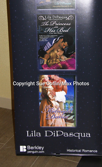 """Author Lila DePasqua """"The Princess in his Bed"""" - poster at Romantic Times Booklovers Annual Convention 2011 - The Book Industry Event of the Year - April 6th to April 10th at the Westin Bonaventure, Los Angeles, California for readers, authors, booksellers, publishers, editors, agents and tomorrow's novelists - the aspiring writers. (Photo by Sue Coflin/Max Photos)"""