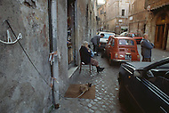 "April 27, 1990, Rome, Italy. Photographing for the book ""One day in the life of Italy"", this is an exploration of Rome. Street scene in Trastevere."