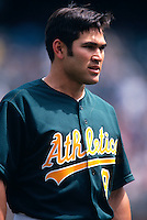 OAKLAND, CA - Johnny Damon of the Oakland Athletics stands on the field during a game at the Oakland Coliseum in Oakland, California in 2001. Photo by Brad Mangin