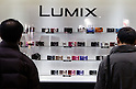 February 9, 2012, Yokohama, Japan - Visitors look at Panasonic Lumix cameras at the CP+ Camera and Photo Imaging Show 2012. The event is held from February 9-12. (Photo by Christopher Jue/AFLO)