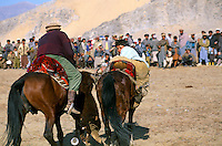 """A Buzkashi between North Alliance Mujahidin in the Panshir valley..""""bOzkashI"""" is one of the ancient games played in Afghanistan. The name of this game is perhaps derived from hunting mountain goats by ancient champions n horseback..-The full text reportage is available on request in Word format"""