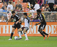 Colorado Rapids defender Kosuke Kimura (27) shields the ball against DC United midfielder Chris Pontius (13) left and midfeilder Clyde Simms (19) right   DC United tied The Colorado Rapids 1-1, at RFK Stadium, Saturday  May 14, 2011.