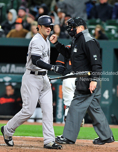 Home plate umpire Mike DiMuro (16) signals &quot;out&quot; after New York Yankees shortstop Pete Kozma (30) swung and missed at a pitch for the third strike and third out in the top of the eighth inning against the Baltimore Orioles at Oriole Park at Camden Yards in Baltimore, MD on Friday, April 7, 2017.  The Orioles won the game 6 - 5.<br /> Credit: Ron Sachs / CNP<br /> (RESTRICTION: NO New York or New Jersey Newspapers or newspapers within a 75 mile radius of New York City)