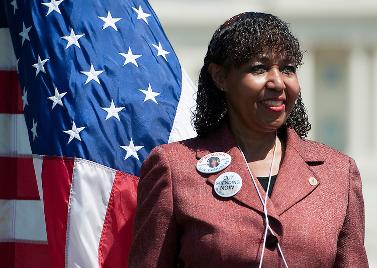 UNITED STATES  APRIL 16: Charlotte Bergmann, Republican candidate for Tennessee's 9th Congressional district, stands on stage during Herman Cain's Revolution on the Hill Tax Day Rally in Washington on MOnday, April 16, 2012. (Photo By Bill Clark/CQ Roll Call)