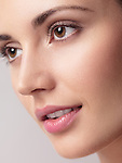 Closeup of a young beautiful woman face with clean natural look and smooth skin