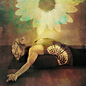 Middle age woman resting on a yoga bolster experiencing a bloom of light in her being.
