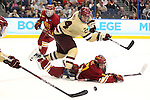 07 APR 2012:  Bill Arnold (24) of Boston College and Brett Wysopal (27) of Ferris State University battle for the puck during the Division I Men's Ice Hockey Championship held at the Tampa Bay Times Forum in Tampa, FL.  Boston College defeated Ferris State 4-1 to win the national title.  Matt Marriott/NCAA Photos