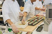 Chefs prepare sushi in the Chelsea Market in New York in The Lobster Place on Friday, May 17, 2013. The market is a favorite destination for tourists and locals alike abounding in a myriad collection of restaurants and other food related businesses. The market is a destination for food tours as well as individuals looking to sample.  (© Richard B. Levine)