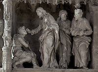 Jesus touches the eyes of a man who was born blind, and heals him while 2 disciples watch on the right. The healing of the blind man, by Pierre Legros, 1683, from the choir screen, Chartres Cathedral, Eure-et-Loir, France. Chartres cathedral was built 1194-1250 and is a fine example of Gothic architecture. It was declared a UNESCO World Heritage Site in 1979. Picture by Manuel Cohen.