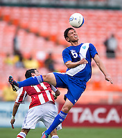 Edgar Benitez (11) of Paraguay fouls Carlos Gallardo (5) of Guatemala during the game at RFK Stadium in Washington, DC.  Guatemala tied Paraguay, 3-3.