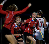 Jena Cacciatore (9) of Ohio State celebrates a goal with teammates Danica Deckard (23) and Aisling McKeon (6) during the NCAA Field Hockey Championship semfinals in College Park, MD.  Maryland defeated Ohio State, 3-1.