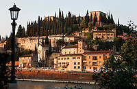 Low angle view of the Hill of Castel San Pietro from the bank of the Adige river, Verona, Italy. High above the city is perched this barracks dating from the Austrian period of Veronas's history, 1798-1866. Picture by Manuel Cohen.