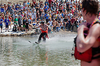 """Cushing Classic at Squaw Valley 21"" - Photograph of a skier crossing a pond during the Cushing Classic at Squaw Valley, USA."