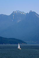 Sailboat with Coast mountains in the background, Vancouver, British Columbia, Canada