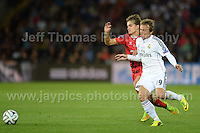 Cardiff City Stadium, Cardiff, South Wales - Tuesday 12th Aug 2014 - UEFA Super Cup Final - Real Madrid v Sevilla - <br /> <br /> Sevilla&rsquo;s Denis Su&aring;rez battles with Real Madrid&rsquo;s Luka Modric to get to the ball first. <br /> <br /> <br /> <br /> <br /> Photo by Jeff Thomas/Jeff Thomas Photography