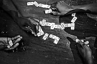 Residents of a camp for those displaced by the recent earthquake play dominos in Petionville, outside Port-au-Prince, Haiti.