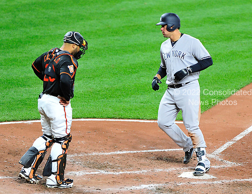 New York Yankees catcher Gary Sanchez (24) scores after connecting for a 2-run home run in the fifth inning giving his team a 5 - 1 lead against the Baltimore Orioles at Oriole Park at Camden Yards in Baltimore, MD on Friday, April 7, 2017.  Baltimore Orioles catcher Welington Castillo (29) looks on.<br /> Credit: Ron Sachs / CNP<br /> (RESTRICTION: NO New York or New Jersey Newspapers or newspapers within a 75 mile radius of New York City)