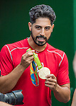 25 August 2016: Washington Nationals starting pitcher Gio Gonzalez holds the hardware of 2016 Olympic Gold medal winner for the USA in women's wrestling Helen Maroulis, prior to a game between the Baltimore Orioles and the Washington Nationals at Nationals Park in Washington, DC. The Nationals blanked the Orioles 4-0 to salvage one game of their 4-game home and away series. Mandatory Credit: Ed Wolfstein Photo *** RAW (NEF) Image File Available ***