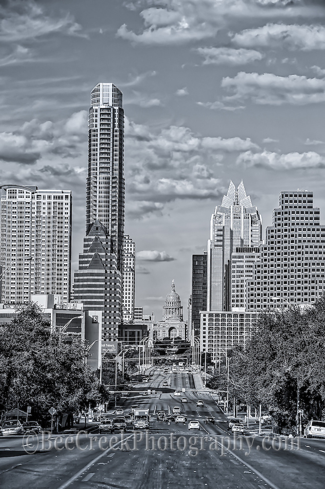 Austin from the view from down South Congress in black and white. View of the downtown with the capitol of Texas.