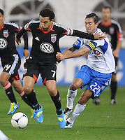 D.C. United forward Dwayne De Rosario (7) shields the ball against Montreal Impact midfielder Davy Arnaud (22) D.C. United tied The Montreal Impact 1-1, at RFK Stadium, Wednesday April 18 , 2012.