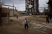 Baku, Azerbaijan .December 14, 2006..Just a few meters from the British Petroleum's massive off-shore platform is being built on shore, is one of the poorest districts near Baku - Bibi Heybat. Most of the residents are refugees from Nagorno-Karabakh region settled here during the war...A child plays in a former Soviet gas factory where 300 people live.