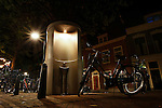A public urinal at night in Delft, Holland