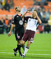 Daniel Woolard (21) D.C. United sighs in relief as Wells Thompson (15) of the Colorado Rapids reacts to a missed shot on goal during the game at RFK Stadium in Washington, DC.  D.C. United tied the Colorado Rapids, 1-1.
