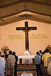 Chile, Easter Island: Catholic Church in the town of Hanga Roa. Sunday mass service..Photo #: ch340-33074..Photo copyright Lee Foster www.fostertravel.com lee@fostertravel.com 510-549-2202