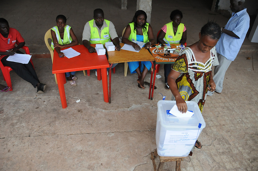 Bissau/June 28 - A voter in Guinea-Bissau casts her ballot in the country's presidential election on June 28. The election comes four months after the leader João Bernardo Vieira was killed by mutinous troops. The West African nation is one of the poorest on the continent--it is ranked 171 out of 179 nations in the U.N. Development Programme's Human Development Index, and life expectancy is less than 46 years. .