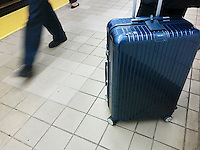 A traveler waits for a train with his Rimowa suitcase on a subway platform in New York on Wednesday, October 5, 2016. LVMH, the French luxury group, will buy an 80 percent stake in the German luggage manufacturer Rimowa for $716 million. Rimowa has been making luggage since 1898.(© Richard B. Levine)