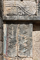 Symbol of power consisting of seven interwoven bars, meaning that the new Quetzalcaan has succeeded in defeating the seven lower levels and taking possesion of the seven virtues that will turn him into a superior man; above part of the plumed serpent running along the upper band of the temple and undulating among countless stylized fish, The Temple of Venus, 1100-1300 AD, Toltec Architecture, Chichen Itza, Yucatan, Mexico. Picture by Manuel Cohen