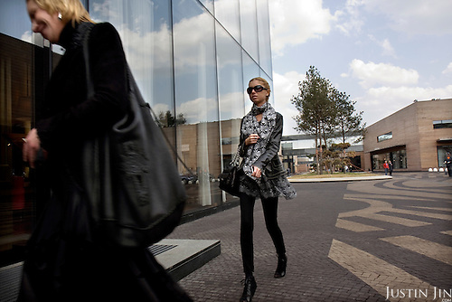 A woman shops at Moscow's Barvikha Luxury Village, home to brands such as Armani, Louis Vuitton, DKNY.