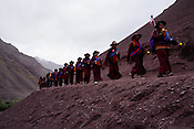 "Buddhist nuns follow His Holiness the Twelfth Gyalwang Drukpa, the head of the Drukpa Lineage during his ""Walking On The World's Rooftop"" Pad Yatra (walk) from Manali to Ladakh. The 400 kms  walk was focused at raising awareness awareness of His Holiness' charitable projects including education, environment and cultural preservation of tribal people from the area. Accompanied on the Yatra by large numbers of Buddhist monks, nuns, foreigners and local villagers. The culmination of the Pad Yatra coincides with the colourful age-old Hemis festival in Leh, Ladakh, India."