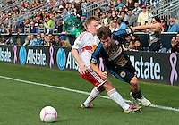 CHESTER, PA - OCTOBER 27, 2012:  Antoine Hoppenot (29) of the Philadelphia Union is tripped by  Dax McCarty (11) of the New York Red Bulls during an MLS match at PPL Park in Chester, PA. on October 27. Red Bulls won 3-0.