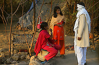 14 year old Sila (seated) is from the Bedia caste in the Bharatpur region of Rajasthan. Traditionally the Bedia see their women enter the sex trade at the age of 13-14. Sila is about to enter the profession and the bidding war for her virginity has begun. When the highest bid has been secured the client may visit Sila as much as he likes over the course of 10 days, then with the money paid, the community throws a large party, much like a Wedding Party, to mark her initiation...
