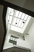 The entrance hall measures seven metres from floor to ceiling and is lit by a large contemporary skylight
