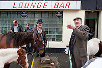 4/10/2010. Michael Barry from Co Clare and Tommy Cullanan (right] from Ennis are pictured making a deal for a horse outside the Emerald bar at the Ballinasloe Horse Fair, Ballinasloe, County Galway, Ireland. Picture James Horan