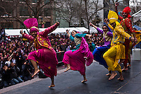 Revellers perform on the stage while they attend the Holi Hai festival organized by Indian community in New York City March 31, 2013. Photo by Eduardo Munoz Alvarez / VIEWpress.
